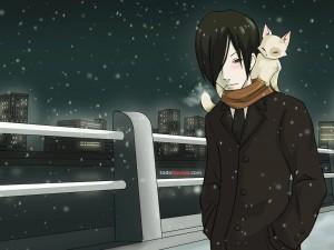 Un chico y su gato, paséan en la noche nevada