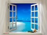 Paradisiaca playa vista desde una ventana