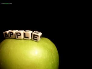 Apple en dados, sobre manzana
