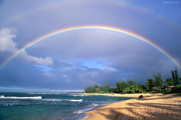 Arcoíris bajo la playa