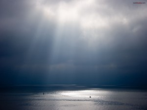 Postal: Cielo nublado sobre el mar