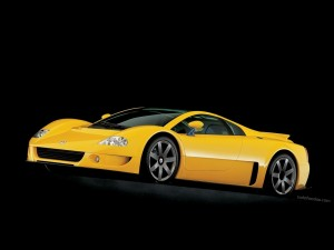Postal: Deportivo amarillo de la marca Volkswagen