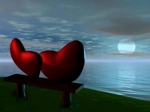 Postal: Corazones enamorados frente a la Luna