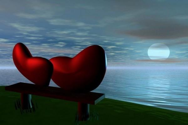 Corazones enamorados frente a la Luna