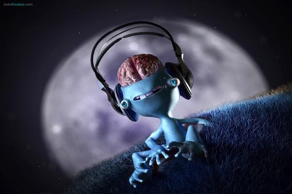 Pequeño extraterrestre escuchando música