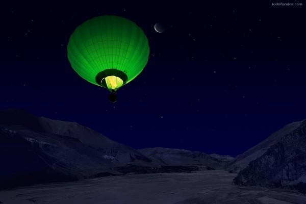 Globo verde volando de noche