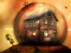 Una vieja casa dentro de una bola de cristal
