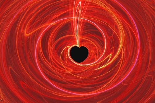 Líneas de luz roja formando un corazón