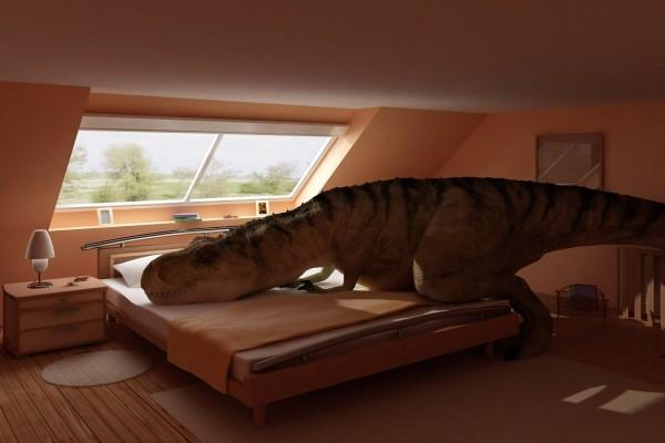 Un dinosaurio sobre la cama