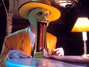 """Postal: """"La máscara"""" con la lengua fuera"""