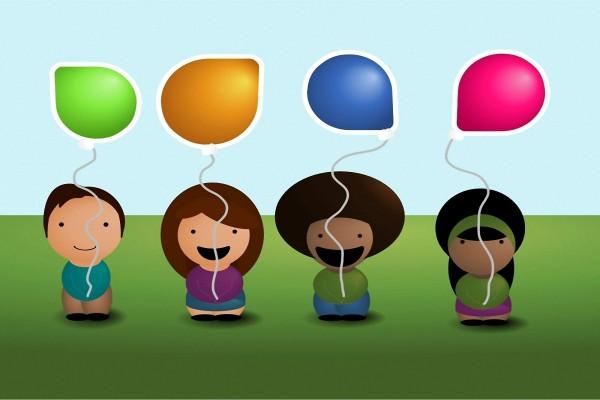 Niños felices con globos de colores