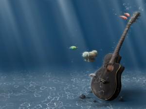 Postal: Guitarra en el fondo del mar