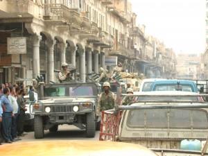 Postal: Soldados americanos ocupando una ciudad
