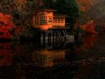 Casa naranja flotante construida a orillas de un lago