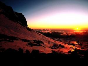 Postal: Un amanecer por encima de las nubes