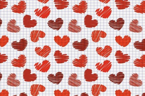 Papel cuadriculado con corazones