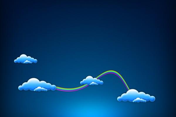 Un arco iris conectando las nubes
