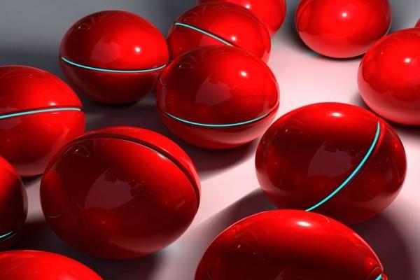 Esferas rojas con una línea de luz azul