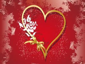 Corazón con un lazo dorado