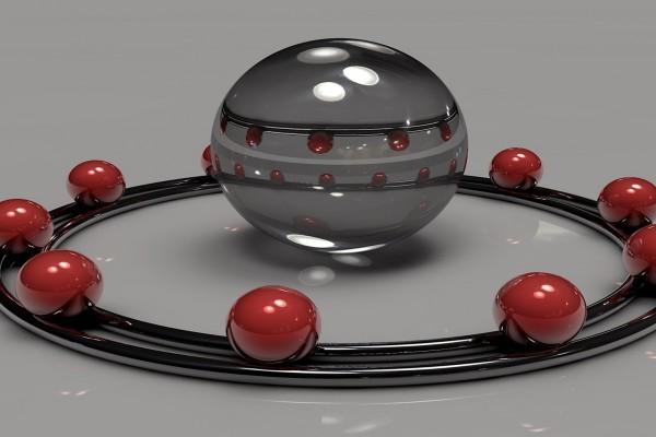 Bolas rojas rodeando una mayor