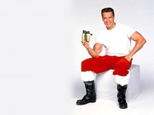Postal: Arnold Schwarzenegger vestido de Papá Noel