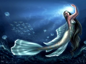Postal: Sirena bailando entre peces