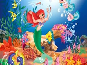 Postal: La Sirenita de Disney bailando bajo el mar
