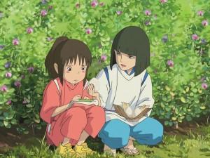 Haku ofreciendo comida a Chihiro