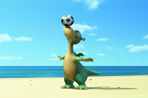 Impy el dinosaurio con un balón de fútbol