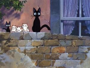 Postal: Gatitos en la tapia