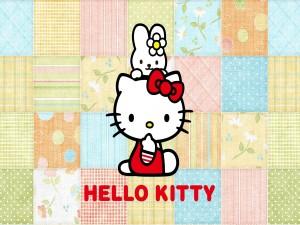 Postal: Hello Kitty sobre un fondo de telas