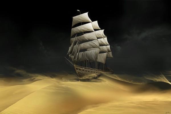 Barco navegando por la arena