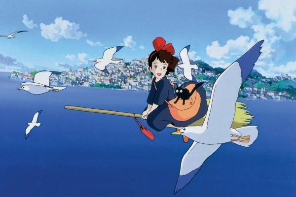 Niki volando en una escoba con su gato