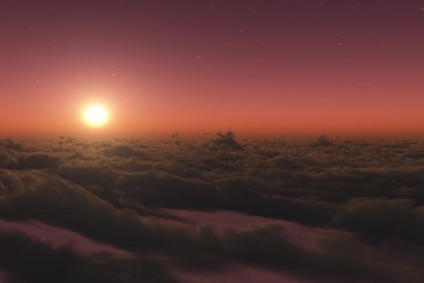 Cielo estrellado con el sol sobre las nubes