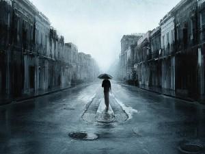 Hombre solitario bajo la lluvia
