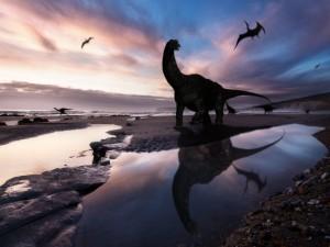 Dinosaurios en una playa
