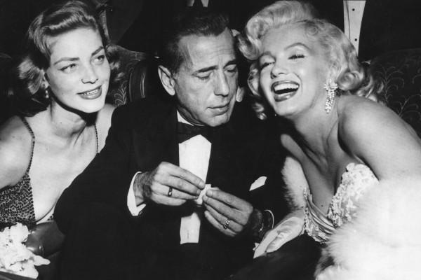 Humphrey Bogart junto a Marilyn Monroe y Lauren Bacall