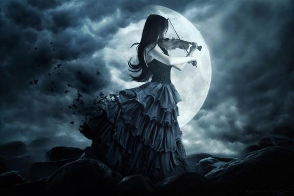Chica gótica tocando el violín