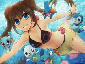 Niña nadando con sus amigos