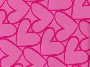 Pared rosa con corazones