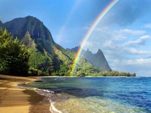 Postal: Arcoíris en una playa