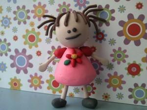 Postal: Muñeca de plastelina