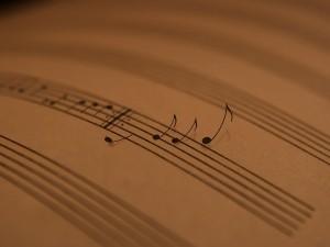 Notas musicales saliendo de la partitura