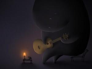 Muñeco enorme tocando la guitarra