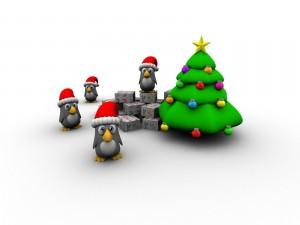 Postal: Pingüinos bajo el árbol de Navidad