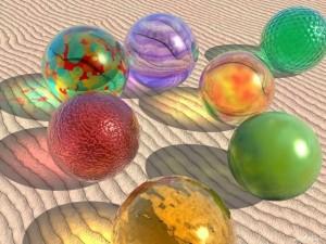 Postal: Esferas en la arena