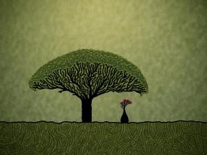 Jarrón con flores bajo un árbol