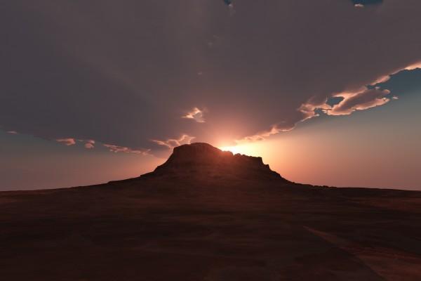 El sol tras la colina