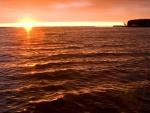 Sale el sol en la playa