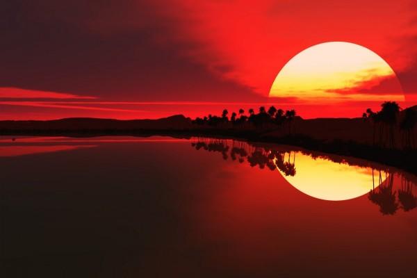 El sol en un cielo rojo